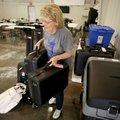 Judy Faulkner, Washington County election official supervisor, moves voting equipment Monday into po...