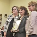 Ashley Williams (center), principal of Jones Elementary School in Bentonville, was honored during th...