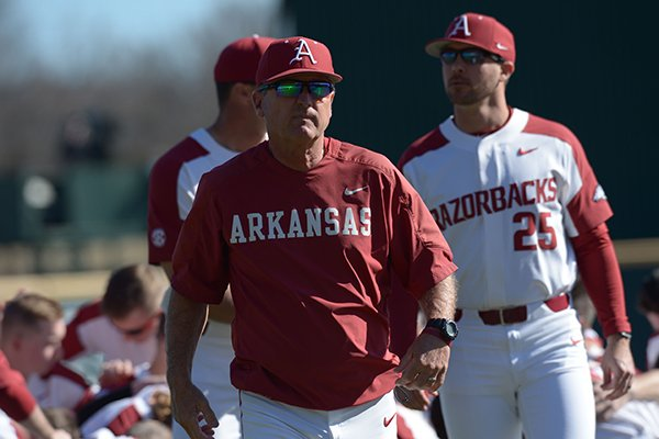 Arkansas coach Dave Van Horn returns to the dugout after speaking to his team before the Razorbacks' game with Southern California Friday, March 2, 2018, at Baum Stadium in Fayetteville.