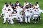 Auburn players celebrate their win with infielder Edouard Julien (10) after he drove in the winning run during the 11th inning of a Southeastern Conference tournament NCAA college baseball game against Kentucky on Tuesday, May 22, 2018, in Hoover, Ala. Auburn won 4-3. (AP Photo/Butch Dill)