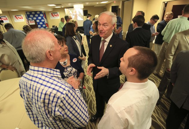 governor-asa-hutchinson-talks-with-supporters-tommy-mitchum-left-of-batesville-vicki-kellar-of-little-rock-and-john-yarbrough-right-of-ward-on-tuesday-night-as-he-greets-supporters-at-a-watch-party-in-little-rock