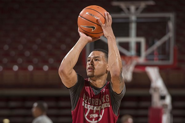 Khalil Garland takes part in practice Tuesday, Oct. 3, 2017, during Arkansas men's baskebtall media day at Bud Walton Arena in Fayetteville.