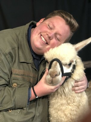 """Noah Davis, 18, poses with the alpaca that """"American Idol"""" adopted for him."""