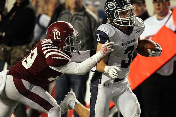 Pine Bluff defender Rod Stinson Jr. (18) tackles Greenwood receiver Peyton Holt during the Class 6A state championship game on Friday, Dec. 1, 2017, in Little Rock.