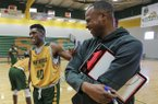 Philander Smith College basketball coach Todd Day, right, jokes with player Rolandis Hall during a practice Jan. 26, 2017, in Little Rock.
