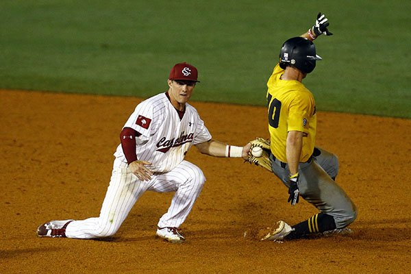 Missouri's Matt Berler (10) beats the tag from South Carolina infielder Justin Row as he slides into second base during the fifth inning of a Southeastern Conference tournament NCAA college baseball game Tuesday, May 22, 2018, in Hoover, Ala. (AP Photo/Butch Dill)