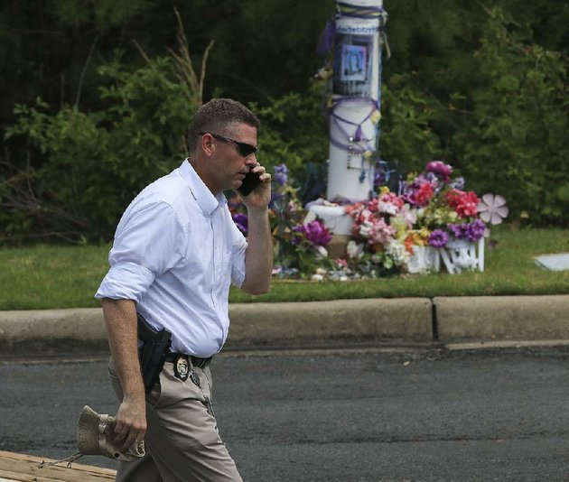 little-rock-police-capt-russell-king-passes-a-memorial-for-ebby-steppach-as-he-works-tuesday-at-chalamont-park-in-west-little-rock