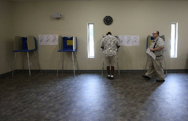 arkansas-democrat-gazettethomas-metthe-5222018-voter-melvin-withers-left-of-woodson-fills-out-his-ballot-as-charles-walderns-right-of-woodson-leaves-the-voting-booth-during-the-primary-election-on-tuesday-may-22-2018-at-new-haven-united-methodist-church-in-hensley