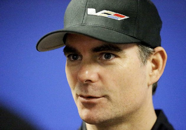 in-this-jan-27-2017-file-photo-jeff-gordon-speaks-with-reporters-after-a-practice-session-for-the-imsa-24-hour-auto-race-at-daytona-international-speedway-in-daytona-beach-fla