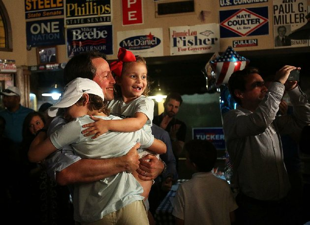 clarke-tucker-celebrates-with-his-children-ellis-left-and-mari-frances-after-making-his-victory-speech-tuesday-night-at-cothams-in-the-city-in-little-rock