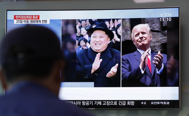 a-man-watches-a-tv-screen-showing-file-footage-of-us-president-donald-trump-right-and-north-korean-leader-kim-jong-un-left-during-a-news-program-at-the-seoul-railway-station-in-seoul-south-korea-wednesday-may-23-2018-ap-photolee-jin-man