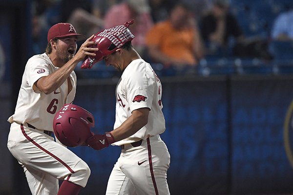 Arkansas infielder Hunter Wilson, left, puts a Hog hat on outfielder Dominic Fletcher after Fletcher hit a home run during the first inning of an SEC Tournament game against South Carolina on Wednesday, May 23, 2018, in Hoover, Ala.