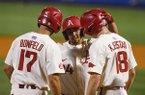 Arkansas' Dominic Fletcher (24) celebrates with Luke Bonfield (17) and Heston Kjerstad (18) after he hit a three-run home run during the first inning of a Southeastern Conference tournament NCAA college baseball game against South Carolina, Wednesday, May 23, 2018, in Hoover, Ala. (AP Photo/Butch Dill)