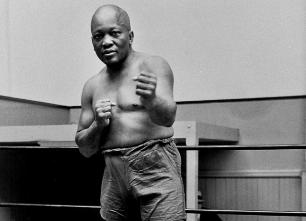 in-this-1932-file-photo-boxer-jack-johnson-the-first-black-world-heavyweight-champion-poses-in-new-york-city