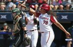 Oklahoma's Jocelyn Alo (78) celebrates in front of Baylor catcher Carlee Wallace, left, after scoring in the first inning of the championship game of the Big 12 softball tournament in Oklahoma City, Saturday, May 12, 2018. (AP Photo/Sue Ogrocki)