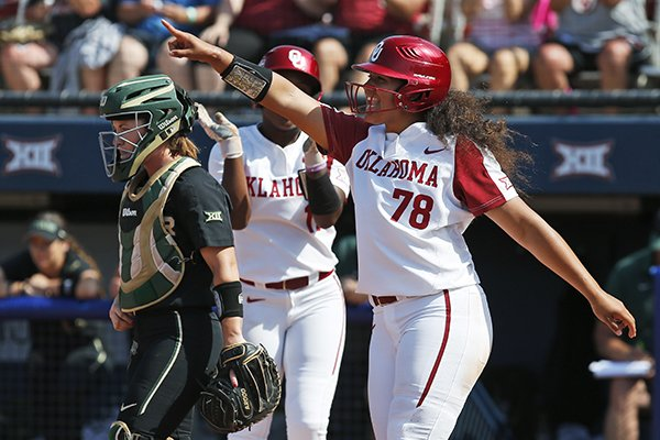 oklahomas-jocelyn-alo-78-celebrates-in-front-of-baylor-catcher-carlee-wallace-left-after-scoring-in-the-first-inning-of-the-championship-game-of-the-big-12-softball-tournament-in-oklahoma-city-saturday-may-12-2018-ap-photosue-ogrocki