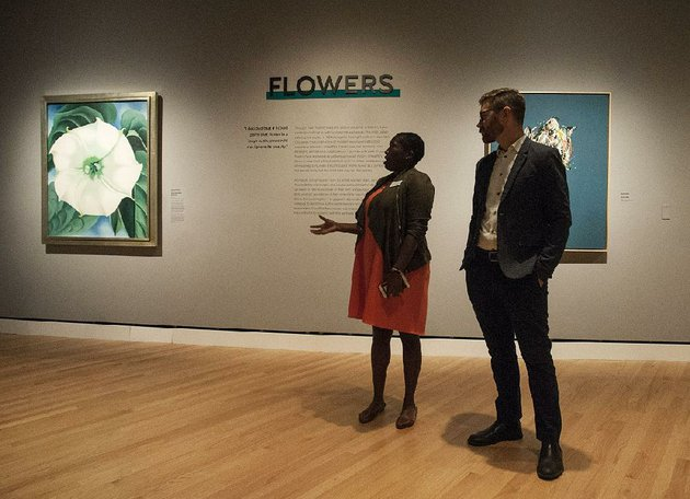 lauren-haynes-and-chad-alligood-co-curators-of-the-beyond-georgia-okeeffe-and-contemporary-art-stand-thursday-near-okeeffes-jimson-weedwhite-flower-no-1-part-of-the-new-exhibit-at-crystal-bridges-museum-of-american-art-in-bentonville