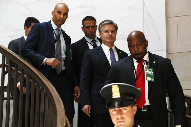 fbi-director-christopher-wray-center-arrives-thursday-on-capitol-hill-for-classified-briefings-with-officials-that-included-white-house-lawyer-emmet-flood-and-chief-of-staff-john-kelly