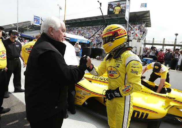 car-owner-roger-penske-left-congratulates-driver-helio-castroneves-after-his-qualifying-run-for-the-indianapolis-500-on-saturday-on-sunday-penske-will-have-four-cars-in-the-indy-500-as-well-as-three-in-nascars-coca-cola-600
