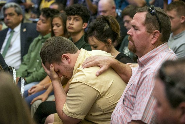 santa-fe-texas-high-school-student-aaron-chenowith-is-comforted-by-his-father-richard-chenowith-during-a-discussion-with-gov-greg-abbott-on-school-shootings-thursday-at-the-texas-state-capitol-in-austin