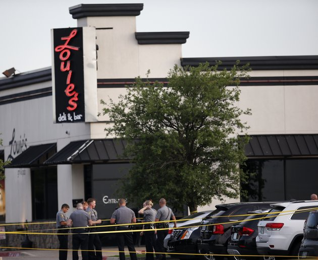 police-officers-stand-at-the-scene-of-a-shooting-on-the-east-side-of-lake-hefner-in-oklahoma-city-thursday-may-24-2018-a-man-armed-with-a-pistol-walked-into-louies-on-the-lake-restaurant-at-the-dinner-hour-and-opened-fire-wounding-two-customers-before-being-shot-dead-by-a-handgun-carrying-civilian-in-the-parking-lot-police-said-sarah-phippsthe-oklahoman-via-ap