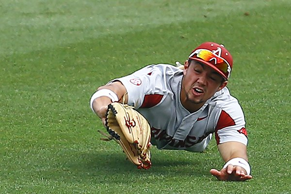 Arkansas outfielder Dominic Fletcher makes a diving catch on a hit from Florida's Nelson Maldonado during the third inning of a Southeastern Conference tournament NCAA college baseball game, Friday, May 25, 2018, in Hoover, Ala. (AP Photo/Butch Dill)