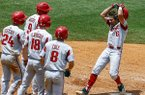 Arkansas' Hunter Wilson (6) celebrates as he crosses home plate after hitting a grand slam during the ninth inning of a Southeastern Conference tournament NCAA college baseball game against Florida, Friday, May 25, 2018, in Hoover, Ala. (AP Photo/Butch Dill)