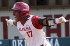 Oklahoma's Shay Knighten celebrates a home run in the third inning against Arkansas during the first game of an NCAA softball super regional in Norman, Okla., Friday, May 25, 2018. (Sarah Phipps/The Oklahoman via AP)