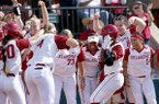 Oklahoma's Shay Knighten (17) celebrates a home run in the third inning against Arkansas during the first game of an NCAA softball super regional in Norman, Okla., Friday, May 25, 2018. (Sarah Phipps/The Oklahoman via AP)