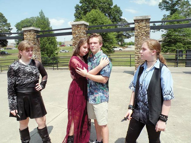 saline-county-shakes-will-present-romeo-and-juliet-by-william-shakespeare-on-thursday-through-june-9-at-the-juli-busken-memorial-amphitheater-in-tyndall-park-in-benton-rehearsing-for-the-play-are-abby-windsor-from-left-who-appears-as-juliets-cousin-tybalt-izzy-hammonds-as-juliet-luke-foster-as-romeo-and-mia-simone-parker-as-benvolio-who-is-a-cousin-to-romeo