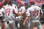 Arkansas' Hunter Wilson (hat) is greeted by teammates after hitting a grand slam during the ninth inning of an SEC Tournament game against Florida on Friday, May 25, 2018, in Hoover, Ala.