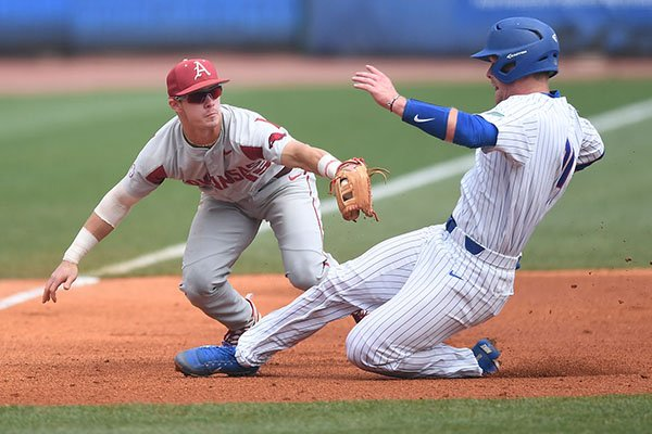 Arkansas third baseman Casey Martin tags out Florida catcher Jonah Girand to end the third inning of an SEC Tournament game Friday, May 25, 2018, in Hoover, Ala.