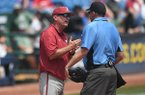 Arkansas coach Dave Van Horn talks with home plate umpire Kevin Sweeney during an SEC Tournament game against Florida in Hoover, Ala.