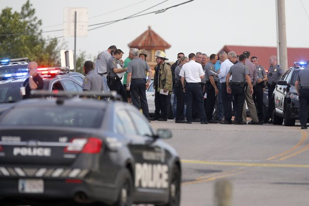 police-and-emergency-personnel-surround-the-scene-of-a-shooting-at-lake-hefner-in-oklahoma-city-thursday-may-24-2018-a-man-armed-with-a-pistol-walked-into-louies-on-the-lake-restaurant-at-the-dinner-hour-and-opened-fire-wounding-two-customers-before-being-shot-dead-by-a-handgun-carrying-civilian-in-the-parking-lot-police-said-bryan-terrythe-oklahoman-via-ap
