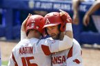 Arkansas' Casey Martin (15) celebrates with Luke Bonfield (17) after hitting a two run homer during the second inning of a Southeastern Conference tournament NCAA college baseball game against Florida, Friday, May 25, 2018, in Hoover, Ala. (AP Photo/Butch Dill)