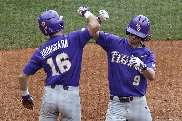 LSU's Zach Watson (9) celebrates with Brandt Broussard (16) after hitting a two-run home run during the sixth inning of a Southeastern Conference tournament NCAA college baseball game against Arkansas, Saturday, May 26, 2018, in Hoover, Ala. (AP Photo/Butch Dill)