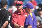 Arkansas coach Dave Van Horn, facing, shakes hands with LSU coach Paul Mainieri prior to an SEC Tournament game Saturday, May 26, 2018, in Hoover, Ala.