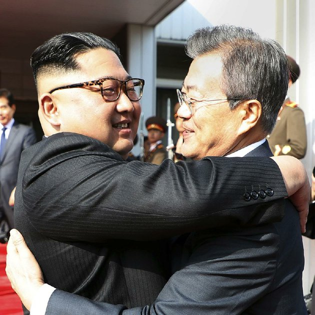 north-korean-leader-kim-jong-un-left-and-south-korean-president-moon-jae-in-embrace-saturday-after-two-hours-of-talks-on-the-north-side-of-panmunjom-in-the-demilitarized-zone-between-their-countries