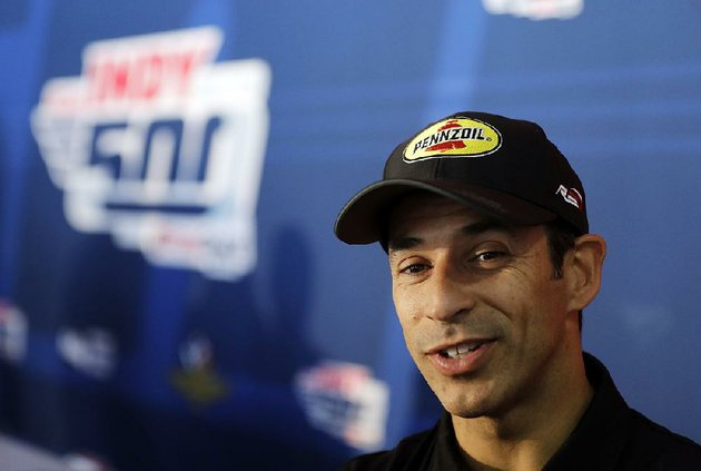 helio-castroneves-of-brazil-speaks-during-a-media-availability-for-the-indycar-indianapolis-500-auto-race-at-indianapolis-motor-speedway-in-indianapolis-thursday-may-24-2018