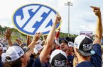 Ole Miss players celebrate after defeating LSU to win the Southeastern Conference tournament NCAA college baseball championship Sunday, May 27, 2018, in Hoover, Ala. (AP Photo/Butch Dill)
