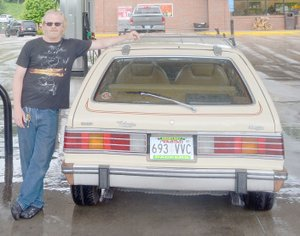 Keith Bryant/The Weekly Vista Justin Brunje stands with his 1985 AMC Eagle wagon.