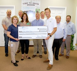 Janelle Jessen/Herald-Leader La-Z-Boy Foundation presented a $45,000 check to Ability Tree on Wednesday morning. Pictured, from left, are Rod Reed, Ability Tree board chairman; Audra Farrell, La-Z-Boy human resources manager; Mike Wilmon, La-Z-Boy production manager; Amy Dunn, Ability Tree director of family and team member relations; Paul Dilbeck, La-Z-Boy quality manager; Neil Erter, La-Z-Boy logistics manager; Joe Butler, Ability Tree director; Rick Wilmoth, La-Z-Boy controller; and Jeff McGarrah, La-Z-Boy materials manager.