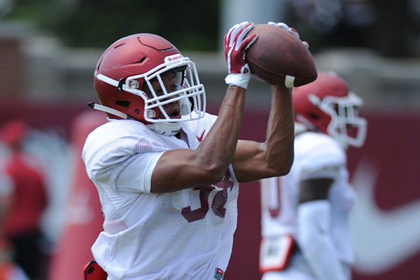 Arkansas defensive back Byron Keaton catches a ball Thursday, Aug. 13, 2015, during practice at the university practice field in Fayetteville.