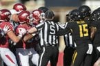 Arkansas and Missouri players are separated by officials during a game Friday, Nov. 25, 2017, in Fayetteville.