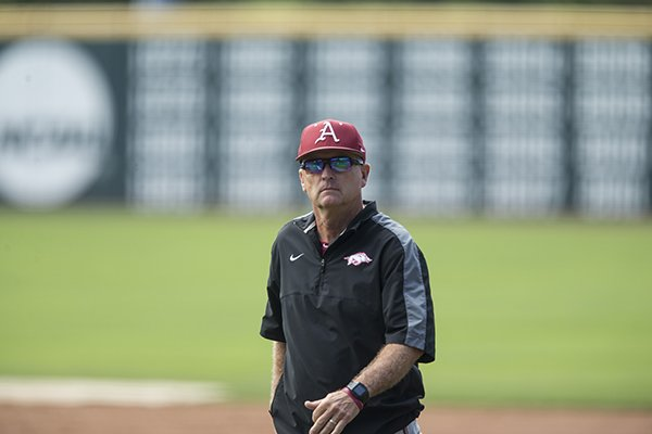 Arkansas coach Dave Van Horn walks across the field during practice Thursday, May 31, 2018, in Fayetteville.