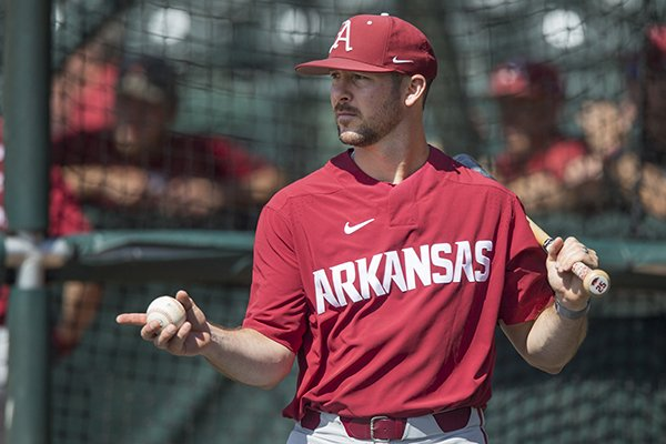 Arkansas volunteer coach Craig Parry instructs during practice Thursday, May 31, 2018, in Fayetteville.