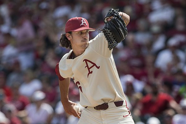 Blaine Knight, Arkansas starter, delivers to an Oral Roberts batter Friday, June 1, 2018, during game one of the NCAA regional at Baum Stadium. Arkansas won 10-2.