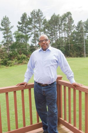 Joe Washington, chairman of the Democratic Party of White County, stands on the back deck of his home in Searcy. Washington, a former bank examiner for the FDIC, retired in 2015 after being diagnosed with muscular dystrophy a few years prior. He became involved with the Democratic Party in White County in 2017 and was elected chairman Jan. 15.