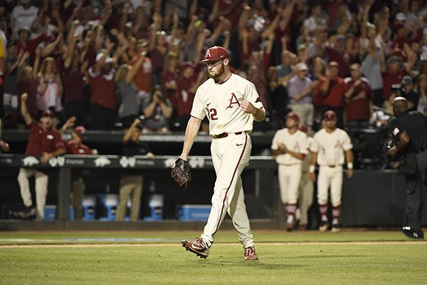 Arkansas pitcher Matt Cronin celebrates after the Razorbacks beat Dallas Baptist 4-3 in a college baseball game in the NCAA regional tournament Sunday, June 3, 2018 in Fayetteville, Ark. (AP Photo/Michael Woods)