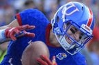 Kansas Jayhawks wide receiver Chase Harrell (3) pulls in a touchdown pass one-handed during the first half of an NCAA college football game in Lawrence, Kan., Saturday, Sept. 2, 2017. (AP Photo/Reed Hoffmann)